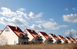 New Family Houses. A row of new identical family houses against a clear blue sky Stock Photos