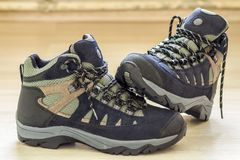 New fashionable hiking mountain boots. Modern leather trekking f Royalty Free Stock Photo