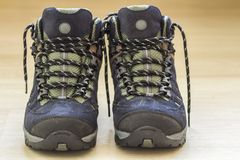 New fashionable hiking mountain boots. Modern leather trekking f Stock Images