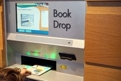 Modern check-in for library books stock photography