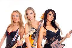 A new female rock band with electric guitars Stock Image