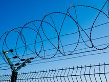 New Fence with Barbed Wire. Detail of New Fence with Barbed Wire Stock Photography