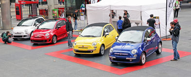 New Fiat 500. Display of new Fiat 500 in different colors of blue, red, yellow and white, at Dundas Square in Toronto, Canada Royalty Free Stock Photos