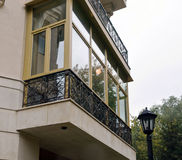 New fiberglass balcony glazing in city house Royalty Free Stock Images