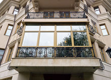 New fiberglass balcony glazing in city house Stock Photos