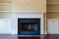 New Fireplace on Hardwood Floor Royalty Free Stock Photos