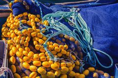 New fishing equipment. Yellow floats and blue fishing net.  royalty free stock photos