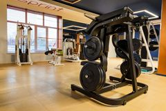 New fitness machines in modern gym interior stock images