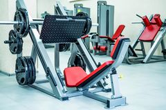 New fitness machines in modern gym interior royalty free stock photography