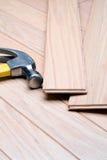 New floor. Installing a new hardwood floor stock photos