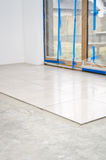 New floor tiles, installation Stock Photo