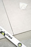 New floor tiles, installation Royalty Free Stock Images