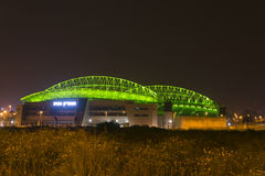 The New Natanya football stadium illuminated at night. The new football stadium illuminated at night view from east in Nenatnya that will host the UEFA 2013 Royalty Free Stock Photo