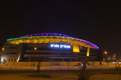 The New Natanya football stadium illuminated at night. The new football stadium illuminated at night view from west in Nenatnya that will host the UEFA 2013 Stock Photos