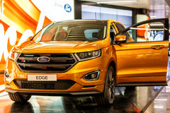 New Ford Edge SUV crossover - Orange. Rome, Italy - May 12, 2016: Ford Edge mid-sized crossover SUV car on exposed during the 2016 Ford Promotion. There is an Stock Photos