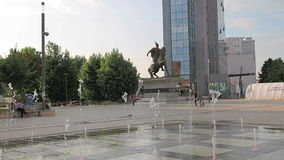 New fountain Scanderbeg Square Pristina. PRISTINA, KOSOVO - JULY 01, 2015: People walking by the new fountain on Scanderbeg square in city center stock video footage