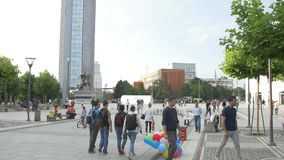 New fountain Scanderbeg Square Pristina. PRISTINA, KOSOVO - JULY 02, 2015: People walking by the new fountain on Scanderbeg square in city center stock video footage