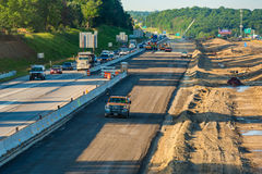 New freeway lanes. BEDFORD HEIGHTS, OH - JUNE 28, 2017: Crews begin the work of adding new lanes to the median of I-271 near Clevelan, while morning traffic stock photo