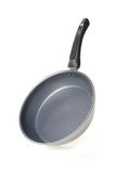 New frying pan on a white background Stock Photography