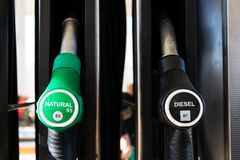 New fuel labeling at petrol station pumps with new EU labels. Sunny day stock photos