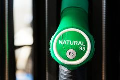 New fuel labeling at petrol station pumps with new EU labels. Sunny day stock images