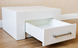 New furniture, cabinet with drawers. New furniture, bedside table with drawer, close-up royalty free stock photos