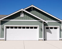 New Garage. Front of a new three car garage Stock Photography