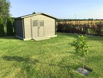 Free New Garden House Or Shed In Green Lawn Or Grass Royalty Free Stock Photo - 196110675