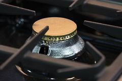 Gas burner gas stove in the kitchen. New gas burner gas stove in the kitchen royalty free stock photography
