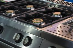 Gas burner gas stove in the kitchen. New gas burner gas stove in the kitchen royalty free stock photo