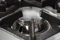 Gas burner gas stove in the kitchen. New gas burner gas stove in the kitchen royalty free stock image