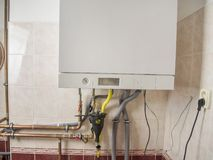 New gas condens boiler for heating and hot water stock photo