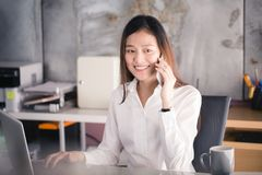 New generation business woman using smartphone,Asian woman are h royalty free stock photography