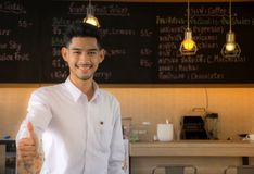 The new generation is committed to the restaurant business. Business Owners. Young man standing at cafe counter. Male at working in coffee shop Royalty Free Stock Photo
