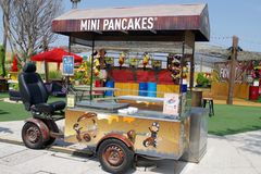 New generation of `food truck` more ecological and funny. Mini truck for mini pancakes and mini bill. royalty free stock photography