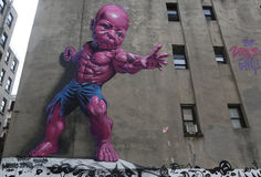 New giant pink Temper Tot mural by Ron English in Little Italy in Manhattan. Stock Photography
