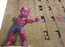 New giant pink Temper Tot mural by Ron English in Little Italy in Manhattan. Stock Photos
