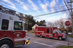 Fire Department trucks. Fire and Rescue meet in an intersection on a call in New Glasgow, Nova Scotia stock photo