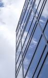 New glass building with reflecting clouds Stock Photography