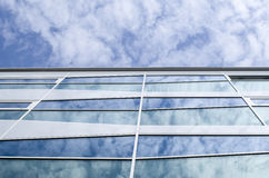 New glass building with reflecting clouds Stock Photo