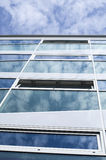 New glass building with reflecting clouds Royalty Free Stock Image