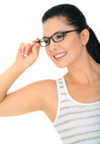 New Glasses. Attractive young woman wearing glasses smiling. isolated on white. promoting glasses royalty free stock photo