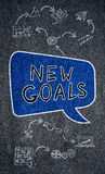New goals concept on a blackboard. New goals concept on a slate background Stock Images