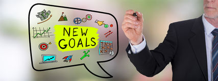New goals concept drawn by a businessman. Businessman drawing a new goals concept Stock Photo