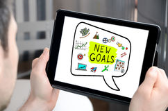 New goals concept on a tablet. Man holding a tablet showing new goals concept Royalty Free Stock Photography