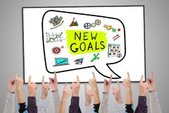 New goals concept on a whiteboard. Pointed by several fingers stock photo