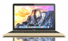 New Gold MacBook Air. New Gold MacBook displaying OS X Yosemite. The New MacBook is not only Apple's thinnest and lightest, but more functional and intuitive Royalty Free Stock Photo