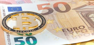 New Golden bitcoin on fifty euro banknotes background. Bitcoin crypto currency, Blockchain technology, digital money, Mining conce. Pt, bitcoin on 50 euro bill stock photography