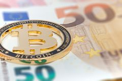 New Golden bitcoin on fifty euro banknotes background. Bitcoin crypto currency, Blockchain technology, digital money, Mining. Concept, bitcoin on 50 euro bill royalty free stock images