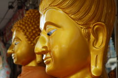 New golden statues. Golden buddhist statues ready to be sold Stock Photos
